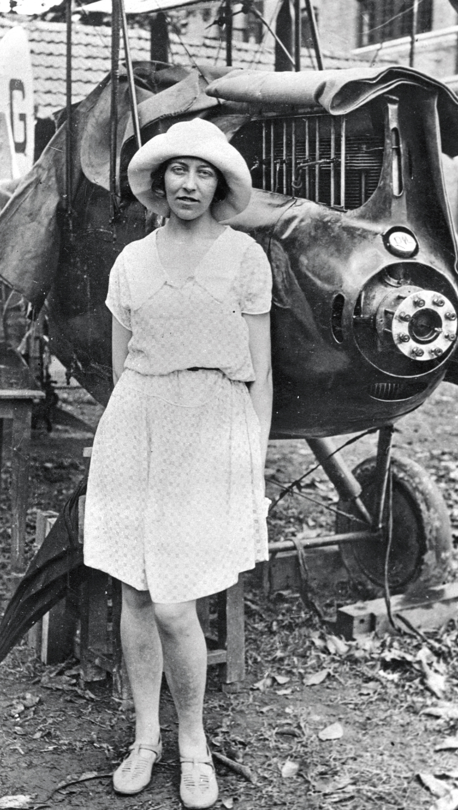 Amy with her badly damaged plane at Insein